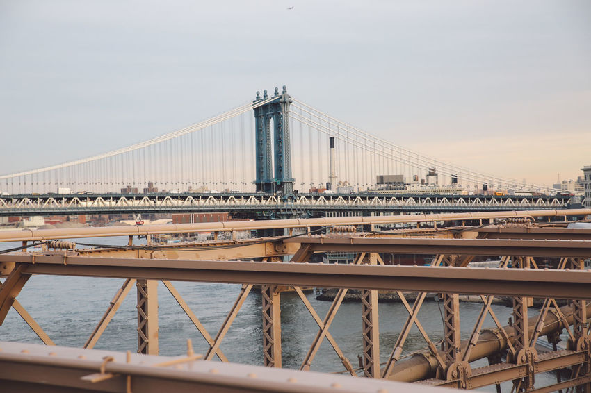Architecture Architecture Bridge - Man Made Structure Brooklyn Bridge  Brooklyn Bridge / New York Built Structure City City Connection Day Engineering New York New York City No People Outdoors River Sky Sunset Suspension Bridge Tourism Transportation Travel Travel Destinations Water Winter
