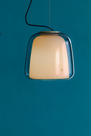 High angle view of a lamp against blue background