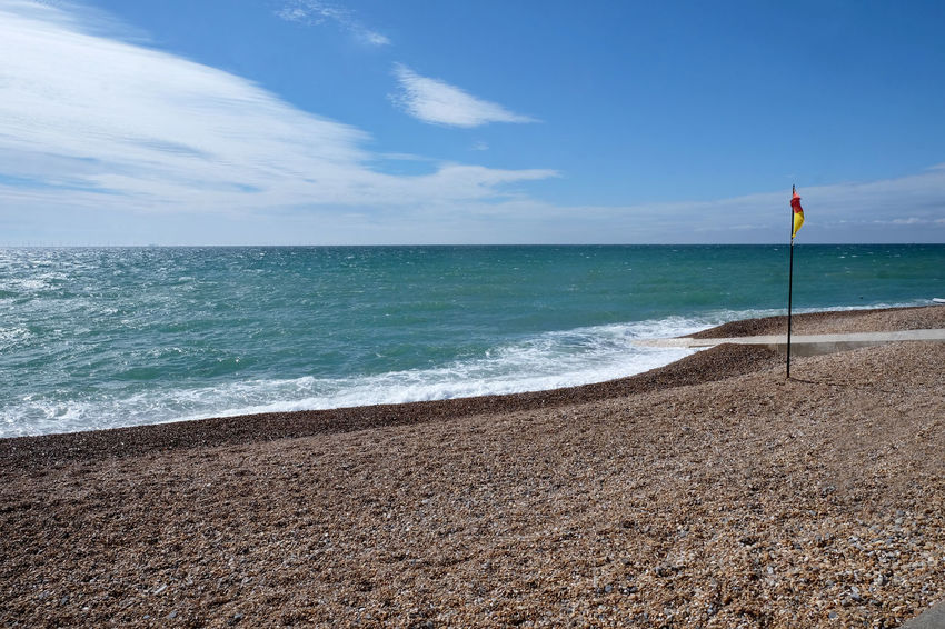 Brighton Beach Beach Beauty In Nature Cloud - Sky Day Flag Horizon Horizon Over Water Land Nature No People Outdoors Sand Scenics - Nature Sea Sky Sport Tranquil Scene Tranquility Water Wave
