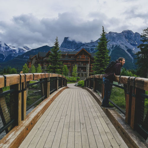 Mountain Tree Sky Cloud - Sky Hiker Snowcapped Mountain Footbridge Bridge - Man Made Structure Arch Bridge Snow Mountain Range A New Beginning Autumn Mood A New Perspective On Life Redefining Menswear My Best Photo Streetwise Photography