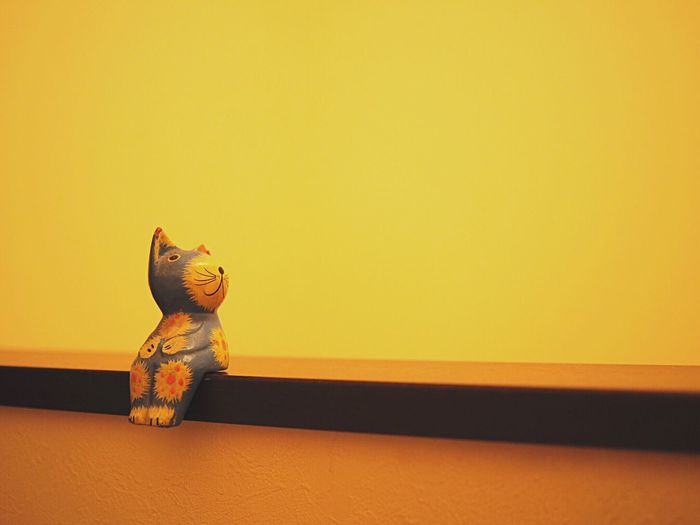 Toy Copy Space Creativity Figurine  No People Human Representation Toy Animal Yellow Stuffed Toy Statue Childhood Indoors  Shelf Sculpture Close-up Stuffed Day Cats 🐱 Story Storytelling In My House Interior Design EyeEmNewHere