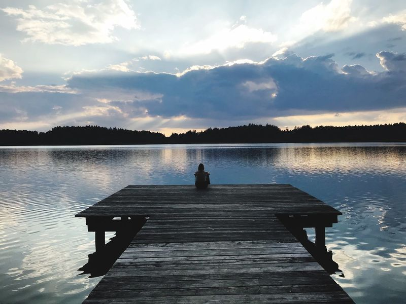 Evening Meditation Water Sky Cloud - Sky Lake Beauty In Nature Pier One Person Nature Reflection Tranquility Real People Tranquil Scene Seat Relaxation Scenics - Nature Silhouette Outdoors