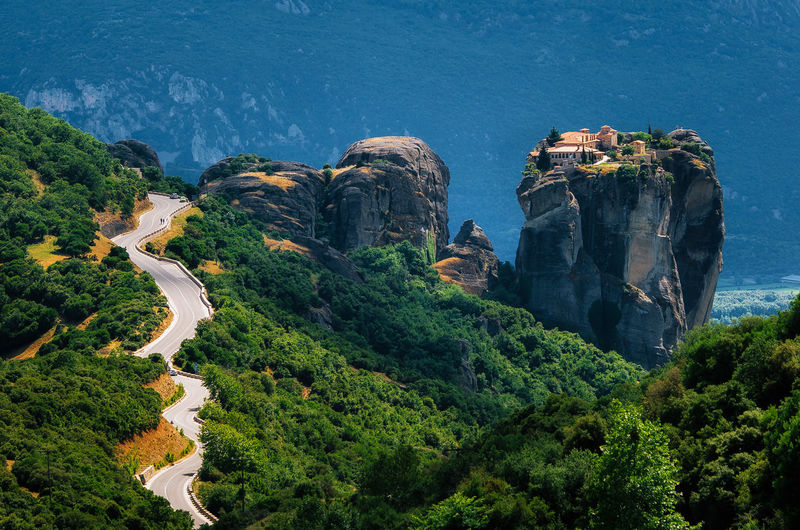 Curve road to Holy Trinity Monastery. Panoramic view of landscape of Meteora, Greece Beauty In Nature Cliff Culture Curve Greece Green Color Landmark Landscape Meteora Monastery Mountains Non-urban Scene Religion Road Rock - Object Rock Formation Scenics Sightseeing Travel Travel Destinations Traveling Tree Found On The Roll Market Reviewers' Top Picks The Great Outdoors - 2016 EyeEm Awards A Bird's Eye View