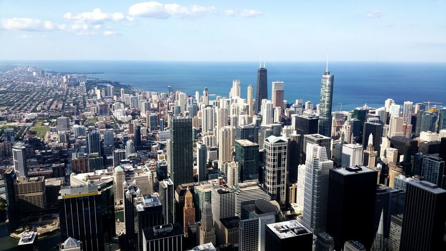 Chicago skyline from willis tower - aerial view of modern buildings in city against sky
