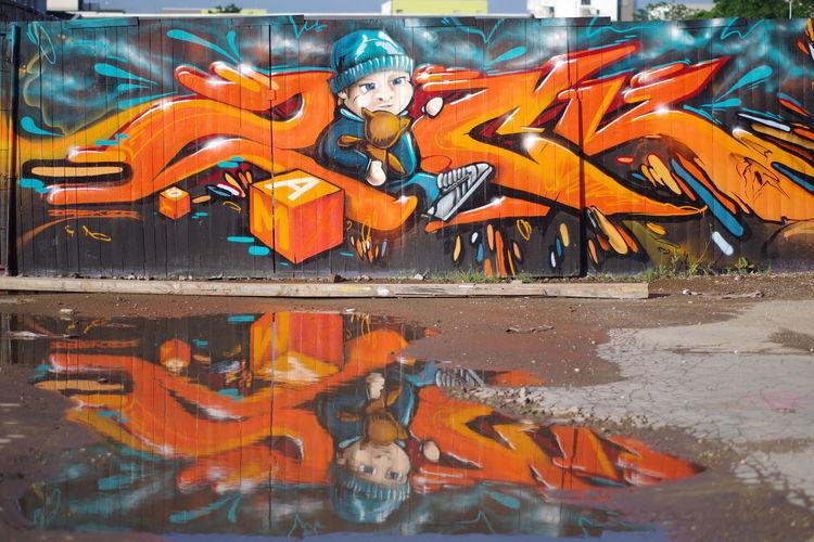 Portrait of graffiti on water