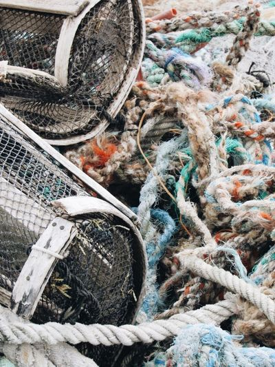 Abandoned ropes and pots in a beach Sailor Fishermen Pots Lobsterpots Ropes Day No People High Angle View Transportation Abandoned Outdoors Plastic Environment - LIMEX IMAGINE Obsolete Decline Deterioration Damaged Close-up Rope Rusty Fishing Net