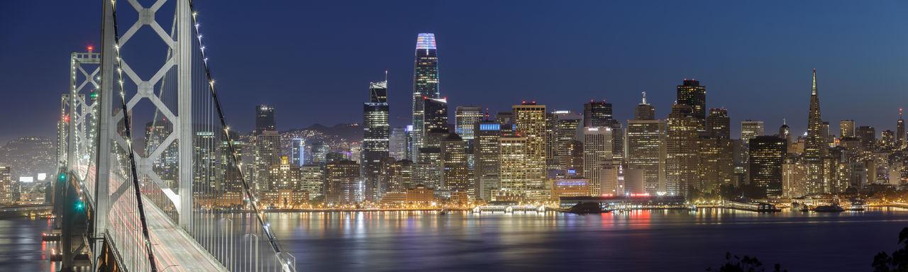 Panoramic views of san francisco bay bridge and waterfront at night via treasure island