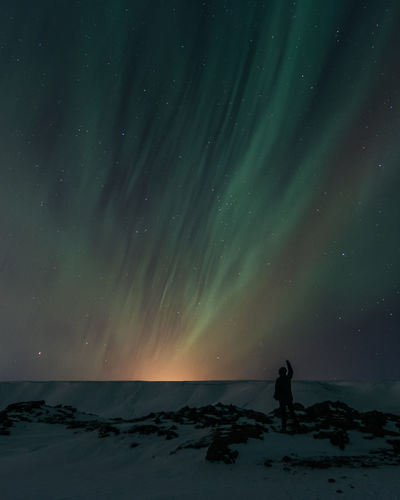 Beauty In Nature Sky Scenics - Nature Astronomy Space Star - Space Night Tranquility Nature Tranquil Scene One Person Star Silhouette Land Standing Idyllic Non-urban Scene Real People Sea Water