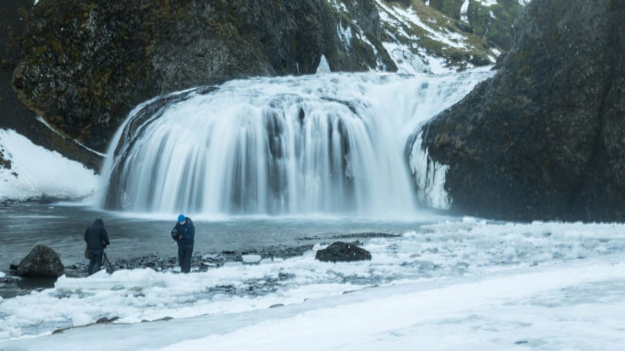 Adult Adventure Beauty In Nature Cold Temperature Day Glacial Long Exposure Motion Nature Outdoors People Rock - Object Snow Standing Water Waterfall Winter