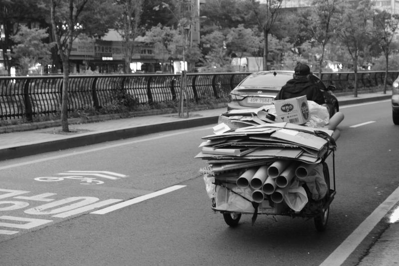 Poor  Mans Transportation Seoul Land Vehicle People Road Car Noir Blackandwhite Photography Bnw Blackandwhite Downtown District Urban Hard Life World Tough Work Nofilter The Street Photographer - 2017 EyeEm Awards
