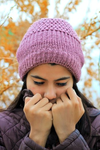 Headshot One Person Portrait Real People Front View Lifestyles Young Women Winter Hat Warm Clothing Leisure Activity Young Adult Clothing Knit Hat Day Close-up Focus On Foreground Human Body Part Human Face Hand Outdoors Scarf Teenager Contemplation