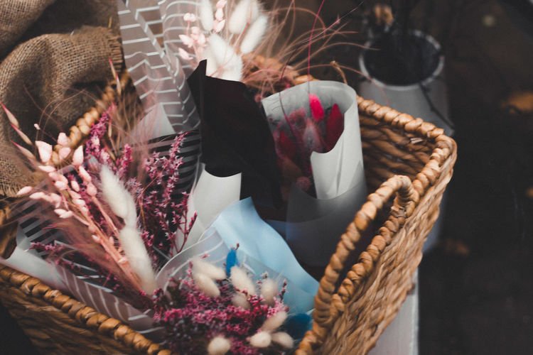Close-up of flowers in wicker basket for sale