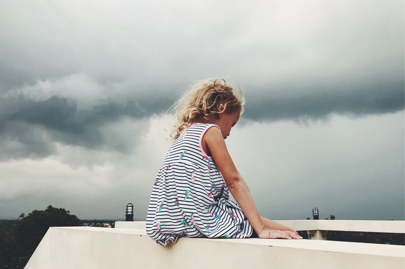 Architecture Blond Hair Casual Clothing Child Childhood Cloud - Sky Day Hair Hairstyle Leisure Activity Lifestyles Looking At View Nature One Person Outdoors Real People Rear View Sky Standing Water Women