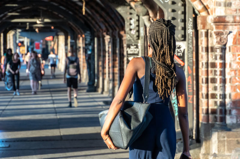 Friedrichshain Oberbaumbrücke Adult Architecture City Clothing Day Dress Fashion Focus On Foreground Hair Hairstyle Incidental People Long Hair One Person Outdoors Real People Rear View Sunlight Three Quarter Length Urban Walking Women #urbanana: The Urban Playground Summer In The City