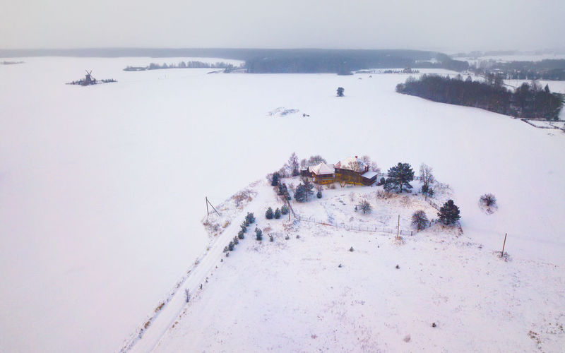 High angle view of snow covered land against sky