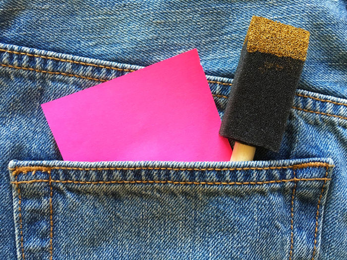Close-up of adhesive note and sponge in back pocket