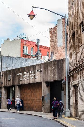 People walking towards post office in city