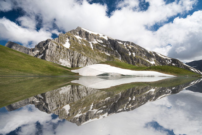 "The majestic alpine lake called ""Dragonlake"" in Epirus, Greece Blue Cloud Clouds Dragonlake Drakolimni Ellada  Glacier Grass Greece Hellas Ice Lake Landmark Landscape Mountain Mountaintop Peak Pond Reflect Reflecting Reflection Reflections Sky Snow Water"