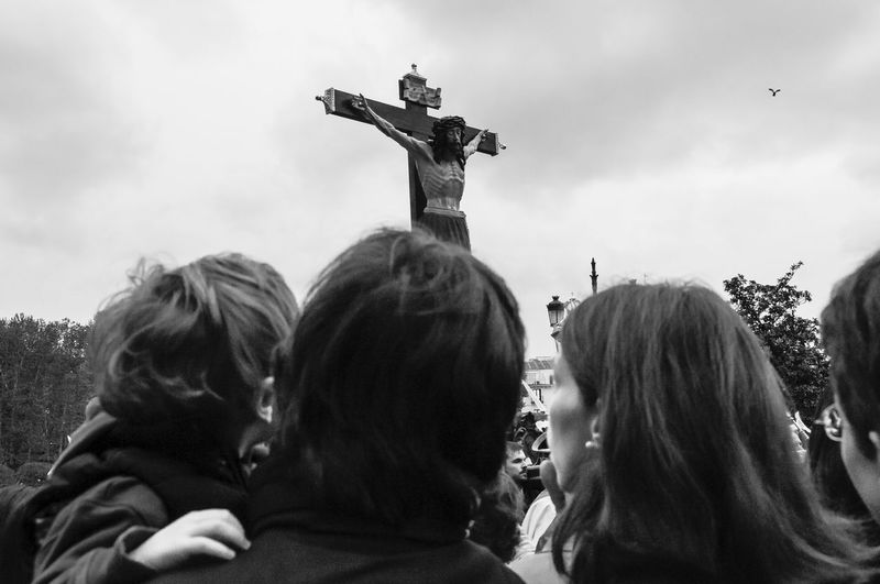 Easter in Madrid 2009: the procession of Cristo de los Alabarderos (Christ of the Halberdier) from the Royal Palace in Madrid. Adult Blackandwhite Christ Christianity Cloud - Sky Crowd Easter Editorial  Fraternity Good Friday HEAD Headshot Madrid Outdoors Pagent People Procession Real People Red Religious  Sky Spectator Statue Togetherness Women