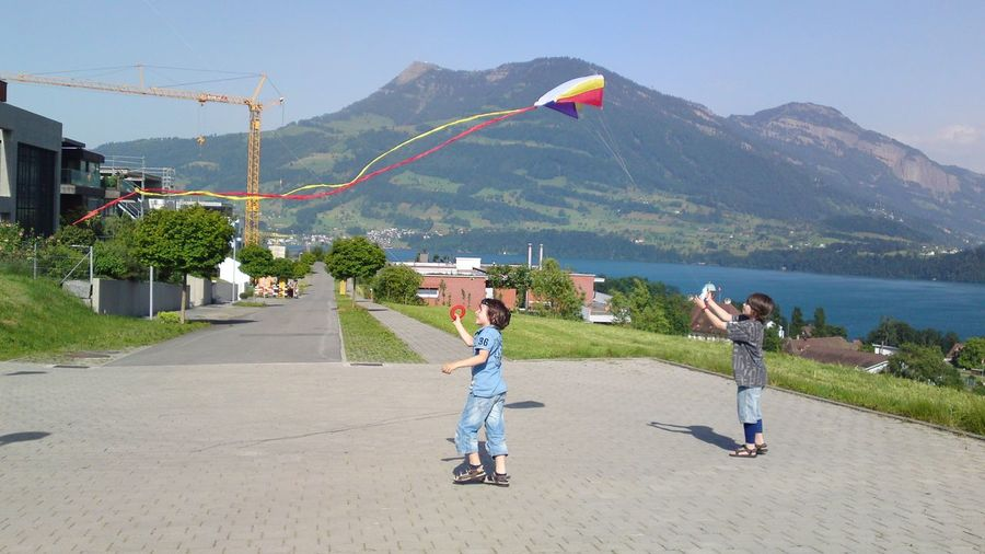 Kids playing outdoors with kite