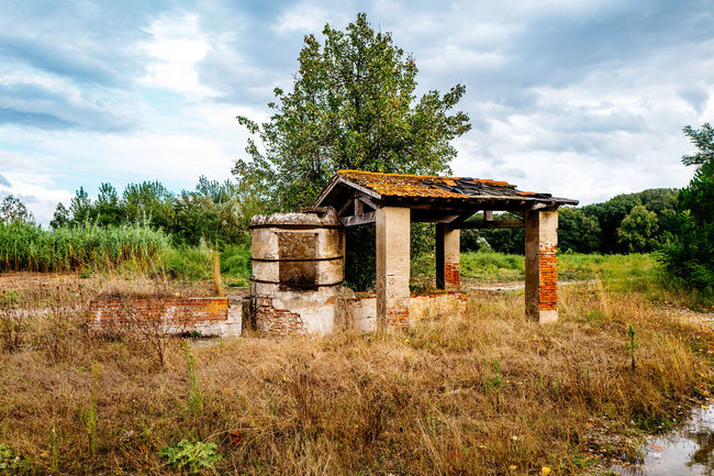 Architecture Beauty In Nature Built Structure Cloud - Sky Cloudy Day Field Grass Grassy Growth Italy Lost Places Lostplaces Nature No People Non-urban Scene Outdoors Remote Scenics Sky Tirrenia Toscana Tranquil Scene Tranquility Tree