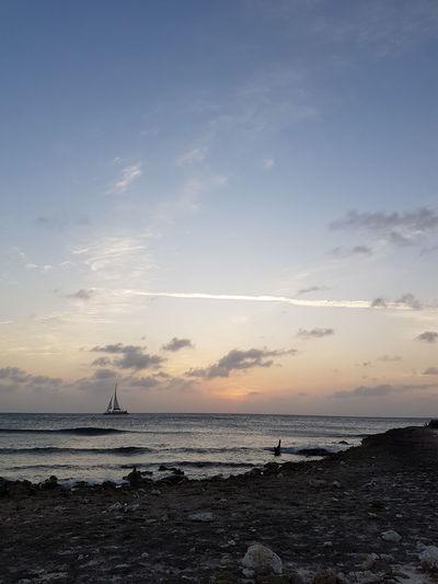 puur natuur Aruba No Edit No Filter Samsungphotography EyeEm Selects Water Low Tide Nautical Vessel Sea Beach Sunset Photography Themes Swimming Sand Silhouette Coastal Feature Rocky Coastline Seascape Romantic Sky