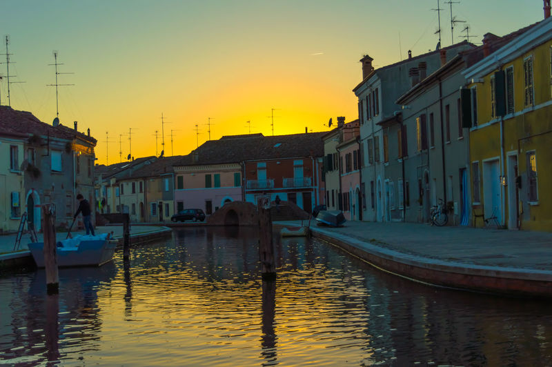Building Exterior Built Structure Architecture Water Residential Structure Canal Waterfront Residential Building City Sunset City Life Dusk House Old Town Rippled Travel Destinations Sky Atmosphere Residential District Townhouse