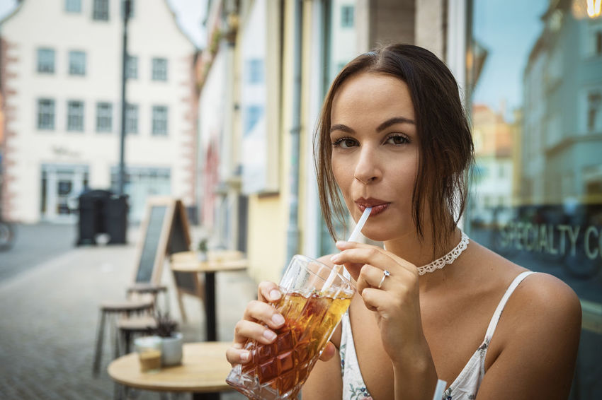 young woman having ice tea Dress Happiness Reflection Summer Exploratorium Adult Beautiful Woman Brunette Girl  Cafe Caucasian Drink Enjoying Life Food And Drink Headshot Ice Tea Indoors  One Person Outdoors Portrait Refreshment Straw Table Window Women Young Adult Young Adults