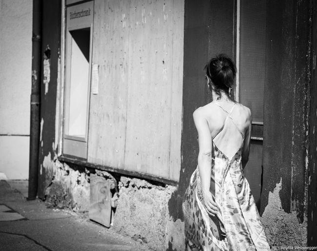 ...like an actress Rear View Real People One Person Women Standing Lifestyles Leisure Activity Architecture Door Built Structure Entrance Three Quarter Length Adult Day Building Exterior Building Hairstyle Fashion Abandoned Outdoors Actress Model