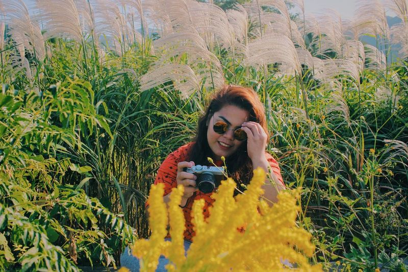 Capture all the good things that makes you happy. Grass Japan Millenials Portrait Photography Women Portraits Of EyeEm Japan Photography Portrait Of A Woman women around the world Flowers,Plants & Garden Plant Front View Lifestyles Leisure Activity Smiling Young Adult One Person Glasses Portrait Growth Sunglasses Young Women Happiness Real People Women Nature Adult Day Looking At Camera Fashion