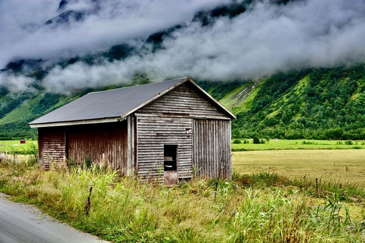 Landscape Wooden Building Wanderlust Travel Photography Scenic Countryside Norway Rural Barn Hut Misty Architecture Plant Built Structure Building Exterior Land Grass Cloud - Sky Nature Rural Scene Environment Outdoors Field