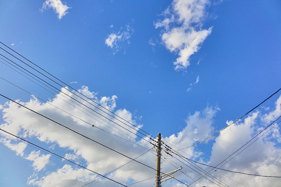 Blue Cable Cloud - Sky Connection Day Electricity  Electricity Pylon Low Angle View Nature No People Outdoors Power Line  Power Supply Sky Sky And Clouds