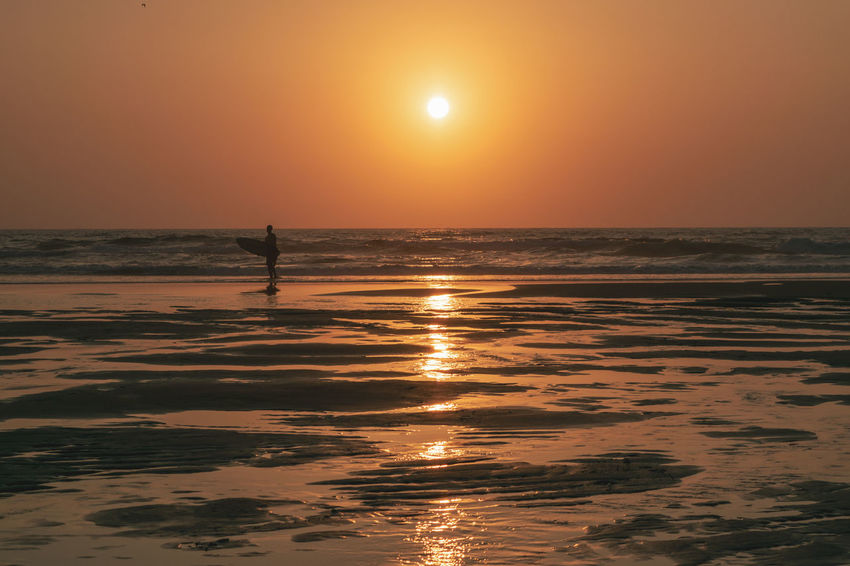 Surf Beach Beauty In Nature Horizon Horizon Over Water Land Leisure Activity Nature One Person Orange Color Outdoors Reflection Scenics Scenics - Nature Sea Silhouette Sky Sun Sunset Surface Level Tranquility Water My Best Travel Photo Capture Tomorrow