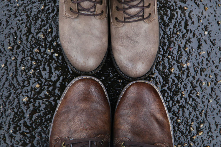 Close-Up Of Shoes On Wet Road