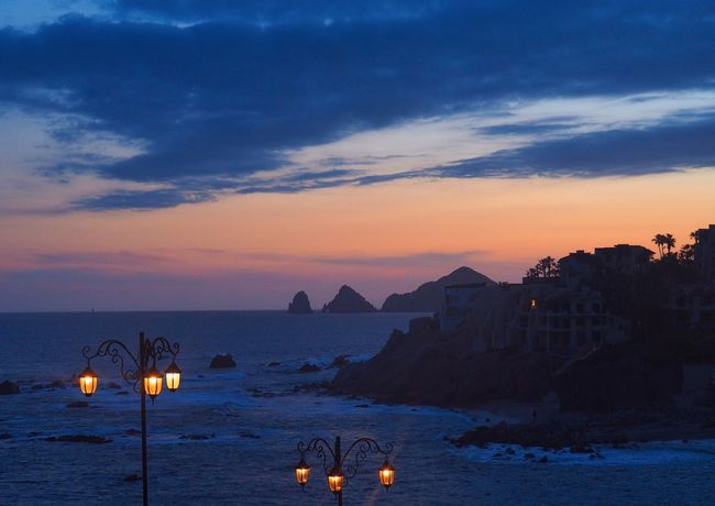 Evening Glow Cabo San Lucas Beauty In Nature Blue Sky Cloud - Sky Evening Glow Evening Sky Horizon Over Water Illuminated Landscape Nature Night Sky Nightfall No People Orange Color Outdoors Romantic Place Rugged Coastline Scenics Sea Sky Sunset Tranquil Scene Tranquility Water