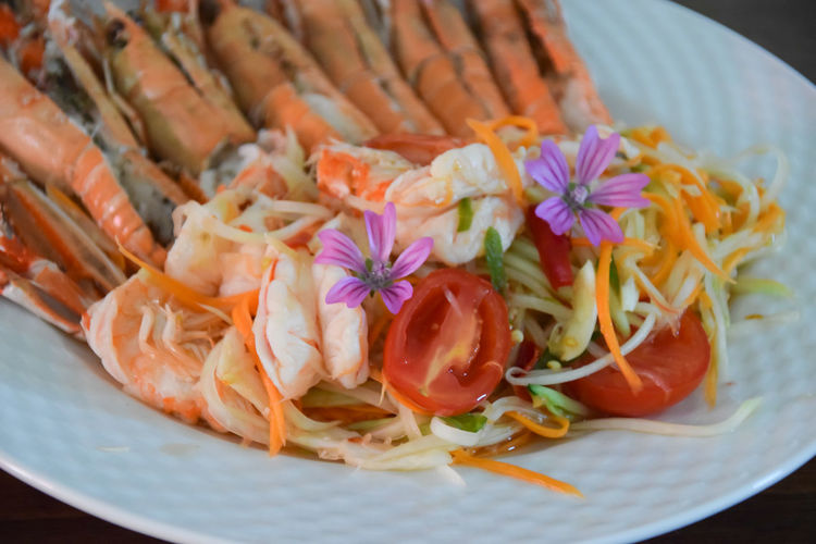 green papaya salad - Som tum thai Edible Flowers Spicy Food Thailand Carrot Close-up Flower Flowering Plant Food Freshness Green Papaya Healthy Eating Mallow Meal Papaya Salad Plate Prawn Ready-to-eat Seafood Serving Size Somtum Still Life Thai Food Tomato Vegetable Wellbeing