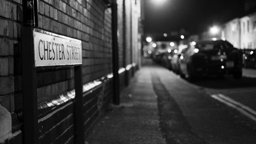 Chester Street Chester Street Street Streetphotography Street Photography Streetphoto_bw Street Light Streetphoto Night Illuminated No People Outdoors City Built Structure Architecture Road Sign Defocused The Graphic City
