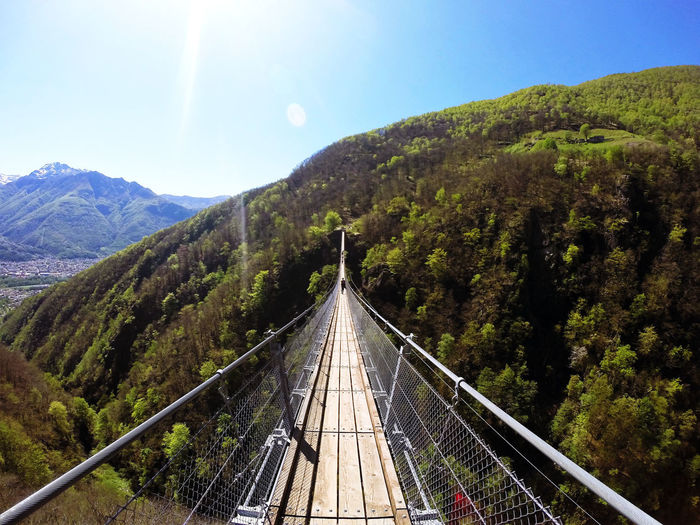 Dramatic tibetan bridge suspended 426 ft. above a forested mountain gorge with scenic views.