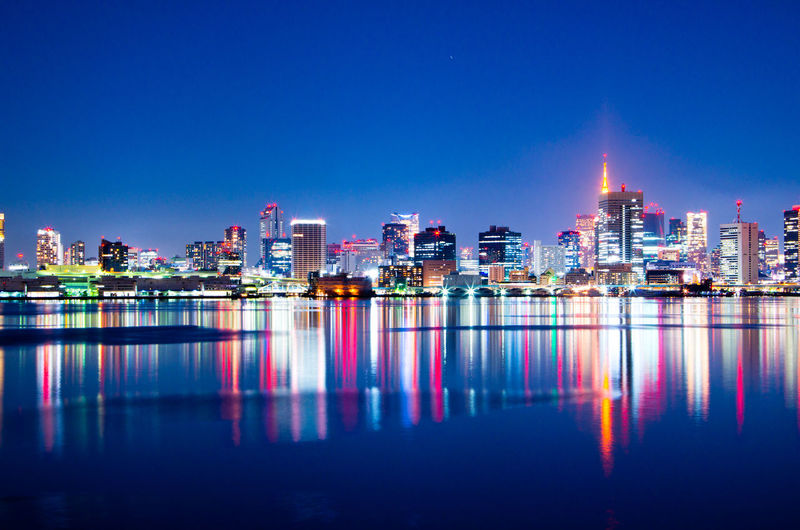 Building Exterior Reflection Architecture Built Structure Water Night City Urban Skyline Building Illuminated Landscape Sky Office Building Exterior Waterfront Skyscraper No People Modern Nature Travel Destinations Cityscape Outdoors Financial District  Nightlife Tokyo Night Japan