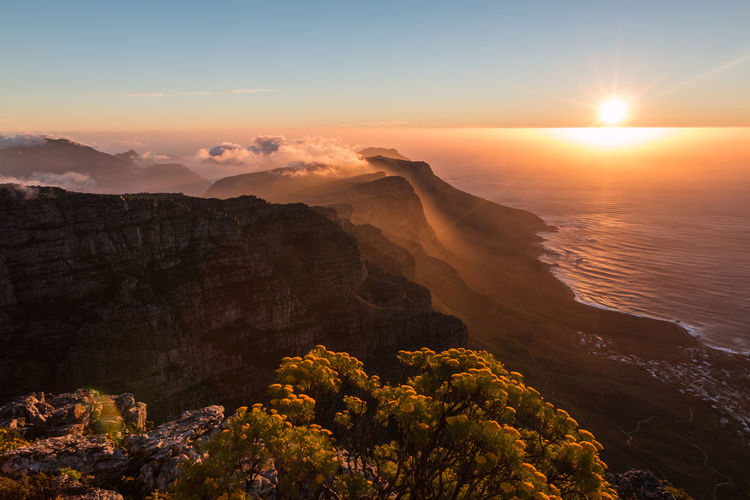 Sunset in table mountain Cape Town Cape Town Cape Town, South Africa Cape Town Beauty South Africa South Africa 🇿🇦 Beauty In Nature Scenics - Nature Sky Sunset Tranquil Scene Tranquility Non-urban Scene Nature Idyllic Rock Sun Mountain No People Solid Water Rock - Object Orange Color Cloud - Sky Sunlight Environment Outdoors Eroded