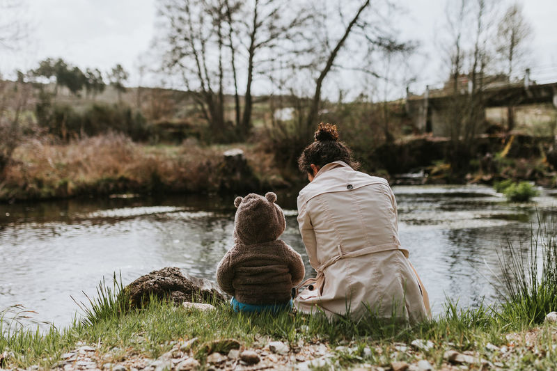 Mother Mother & Daughter Motherhood Family Family With One Child Water Rear View Animal Themes Real People Lake Leisure Activity Outdoors Lifestyles Togetherness Domestic Domestic Animals Travel Destinations Travel Traveling Tranquil Scene River Nature Childhood Children Only Together