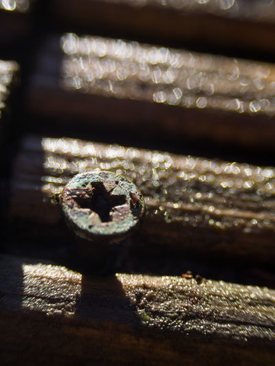 Close-up of metal on table