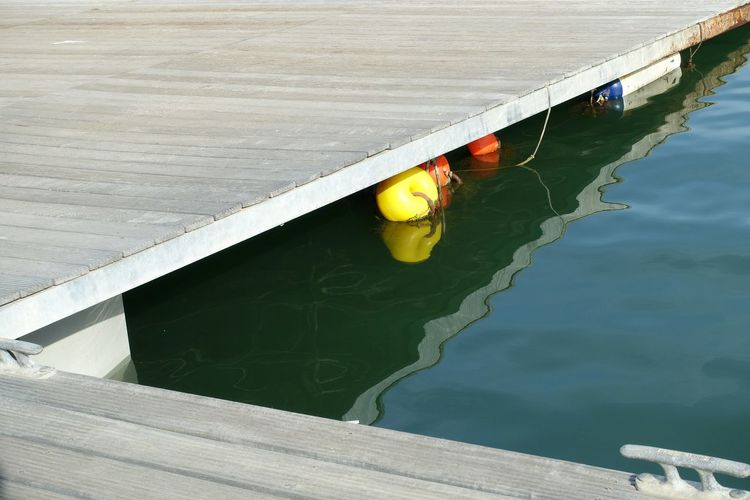Color buoys Water Reflection High Angle View Outdoors Sailing Harbor Buoys Geometry