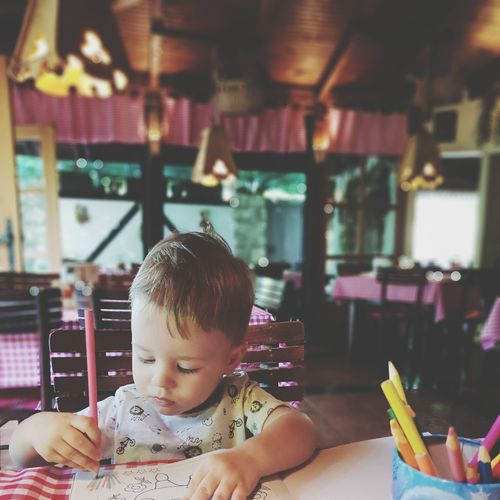 Todler is waiting for a food at the restaurant Colorful Pencil Pencil Drawing Toddler  Cute Lovely Family With One Child Family Only One Child Indoors  Looking At Things Pencil Color Paper Restaurant Waiting Weekend Activities Lunch Time! Child Childhood Smiling Happiness Cheerful Playing Beauty 18-23 Months Babyhood One Baby Boy Only Baby Boys Baby Carriage