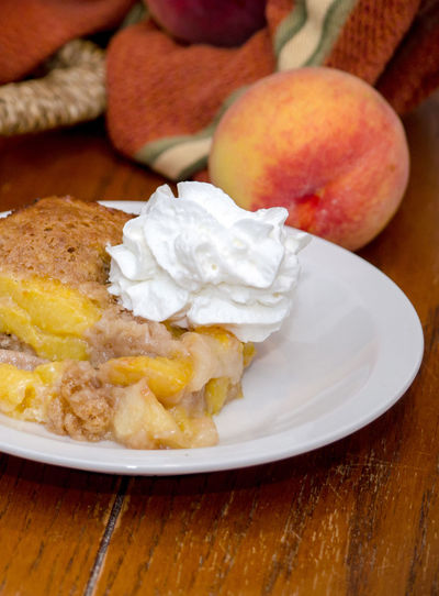 plate of fresh peach cobbler with whipped topping Agriculture Dessert Fresh Produce Hello World Nature Orange Summertime USA Vitamins Food Fresh Fruit Healthy Eating Home Made Juicy Just Picked Michigan Peaches Organic Peach Peach Cobbler Peaches Produce Sweet Tasty Yellow