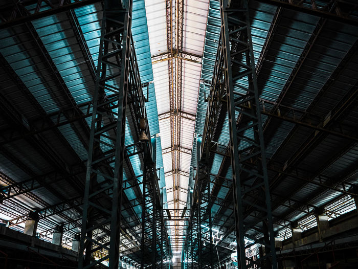 Low angle view of illuminated ceiling at railroad station