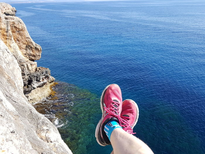 Holiday Vacation Time Vacation View From Above View From The Top View From Rocks Lazy Lazy Day Personal Perspective Human Leg Human Body Part Sea Beach Low Section One Person Water High Angle View Rock - Object Outdoors Women Nature Shoe One Woman Only