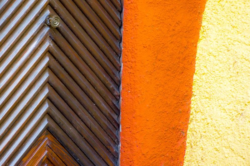 Minimalist Photography  Minimalobsession Minimalist Minimal Orange Built Structure Architecture Wall - Building Feature Day Full Frame Backgrounds Orange Color No People Textured  Sunlight Building Exterior Pattern Close-up Outdoors Yellow High Angle View Shadow
