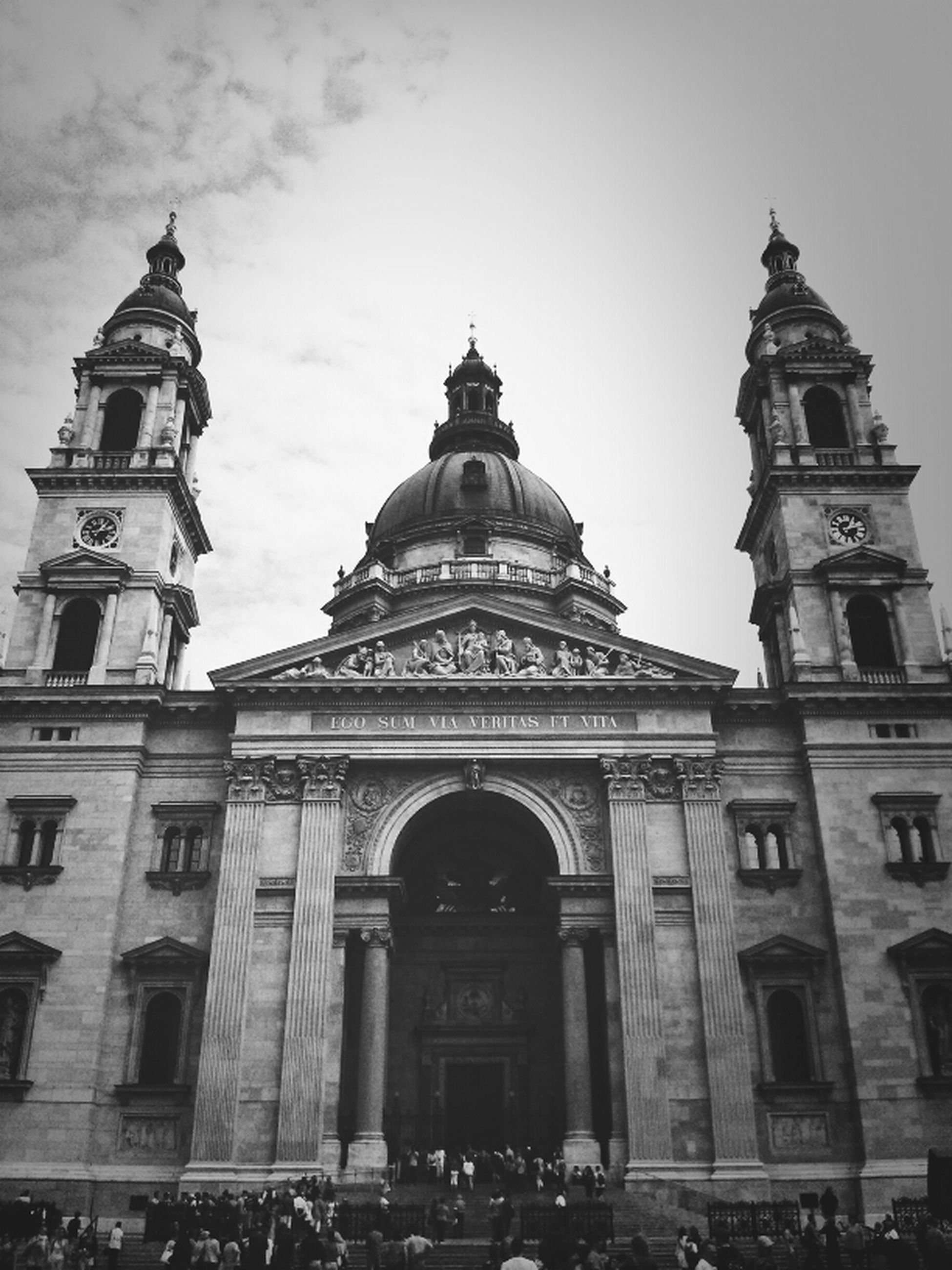 architecture, building exterior, religion, place of worship, church, built structure, spirituality, low angle view, cathedral, sky, facade, dome, travel destinations, history, famous place, cross, arch, day