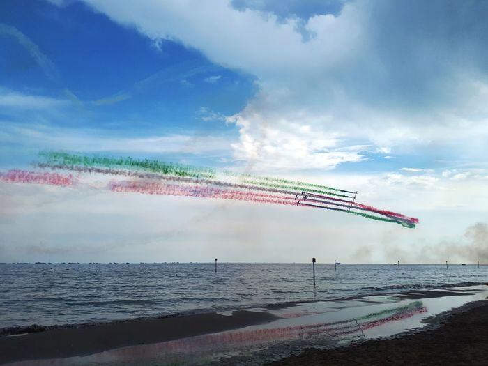 Water Reflections Reflections In The Water Airshow Aerobatics Acrobatic Flight Acrobatic Plane Tricolore Frecce Tricolore Airshow Frecce Tricolori Airshow2018 Fumes Colorful Sky Water Beach Sea Sky Shore Horizon Over Water Sand Ocean Sandy Beach Cloud - Sky Coast The Great Outdoors - 2018 EyeEm Awards